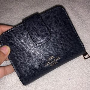Pre own Coach wallet color is navy blue